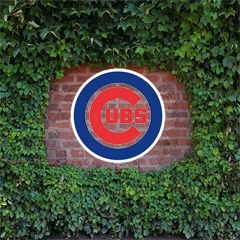 Cubs logo over Wrigely Field vines
